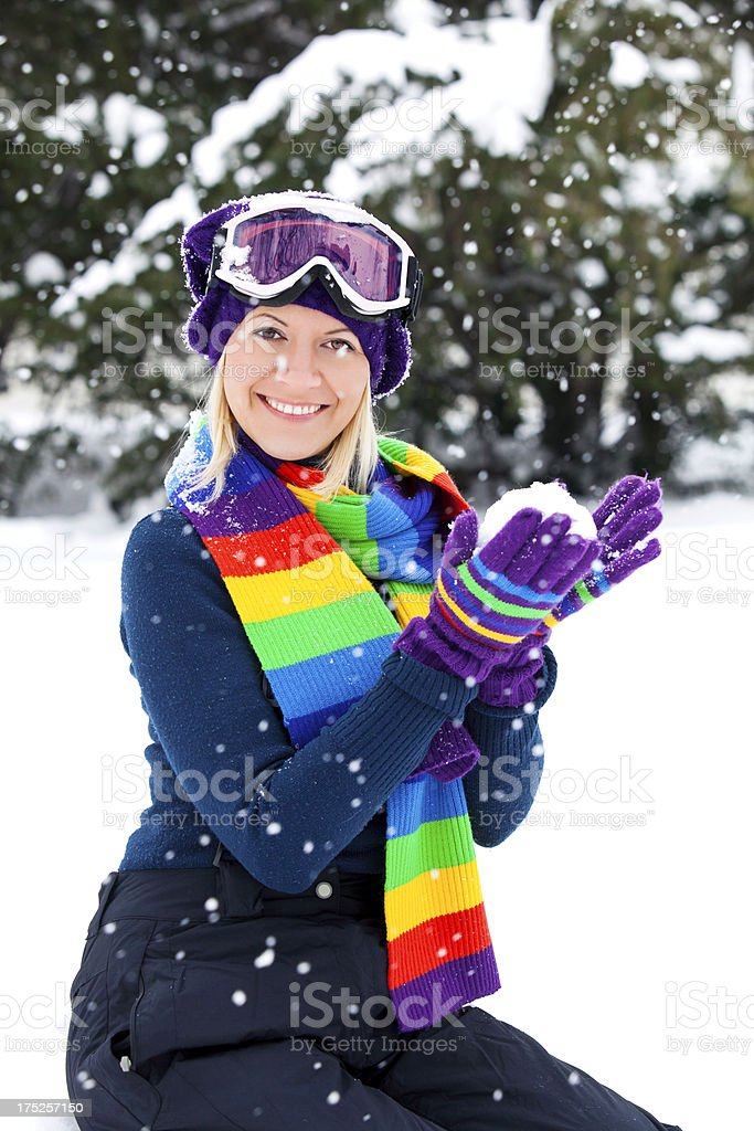 Young woman with snowball royalty-free stock photo
