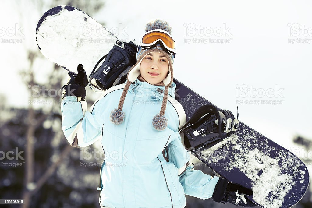 Young woman with snowboard royalty-free stock photo