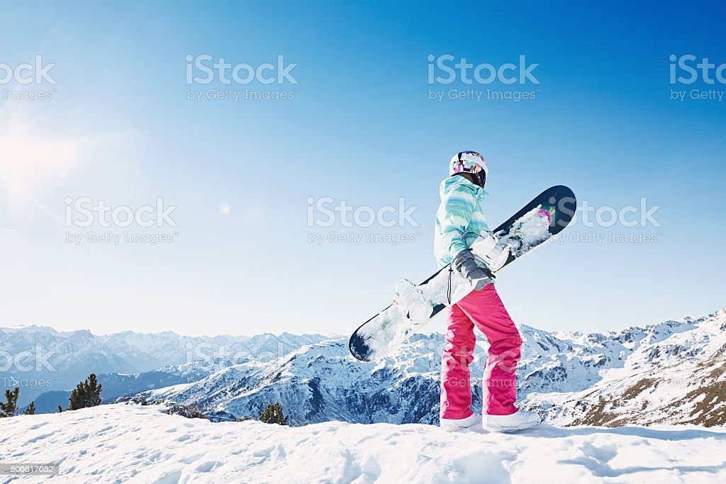 Young woman with snowboard stock photo