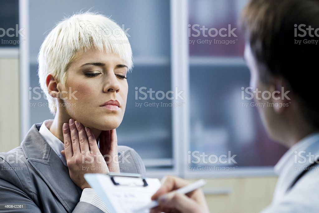 Young woman with sore throat stock photo