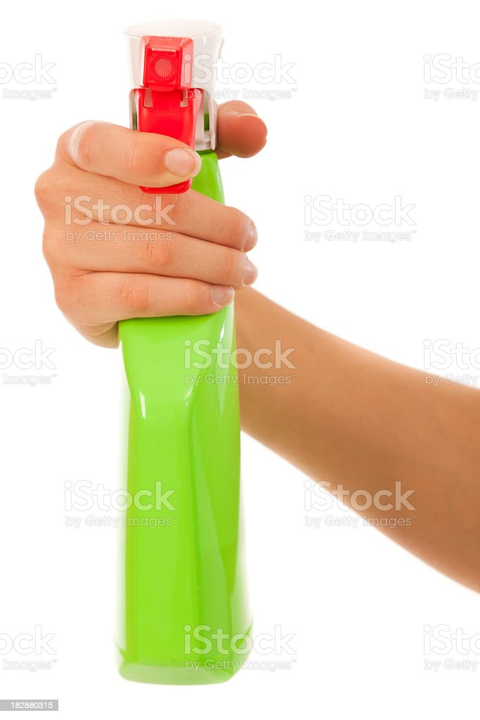 young woman with spray bottle royalty-free stock photo
