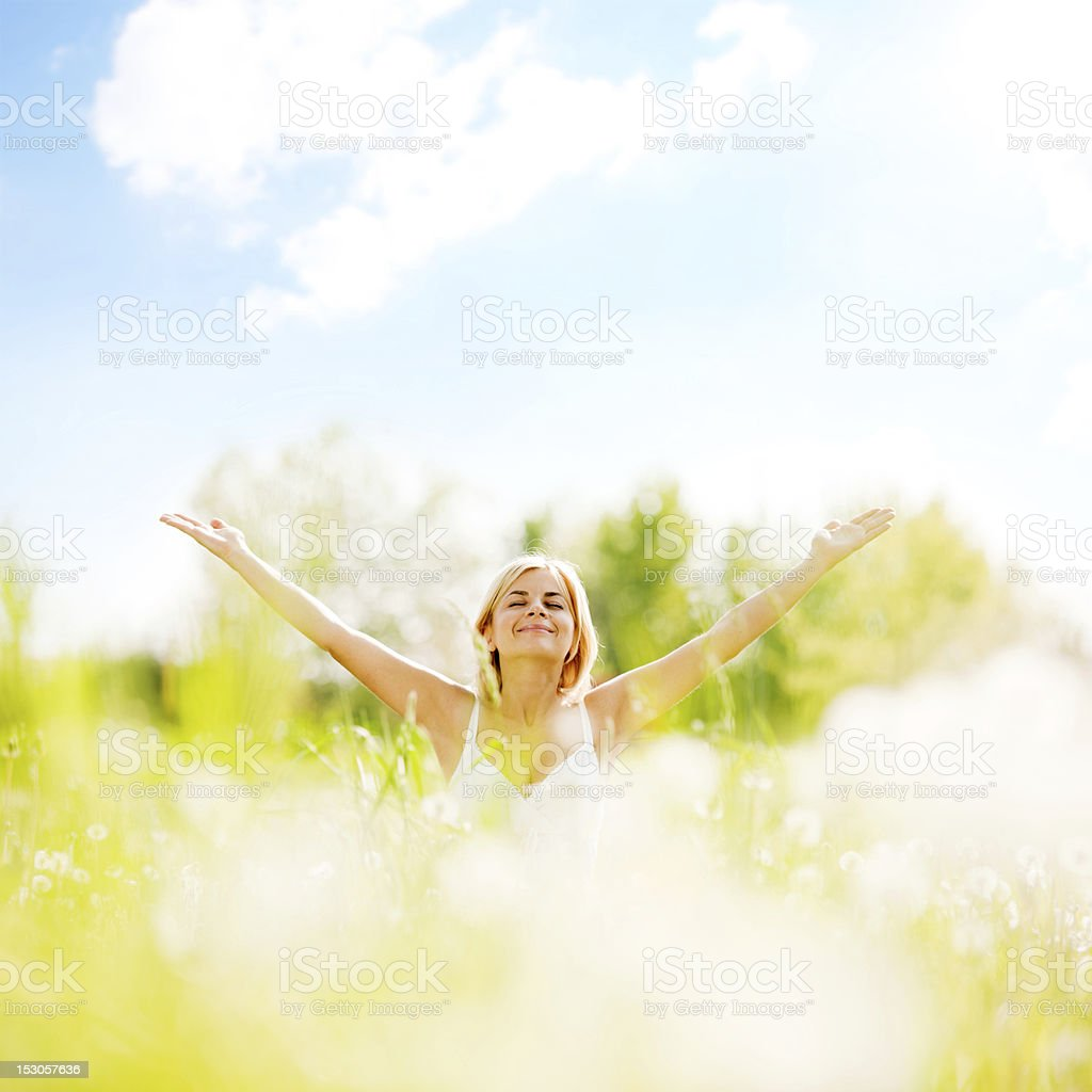 Young woman with spread arms looking up. stock photo