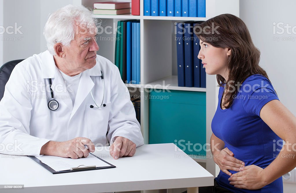 Young woman with stomachache stock photo
