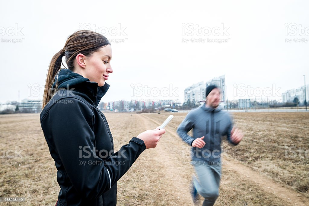 Young woman with stopwatch stock photo