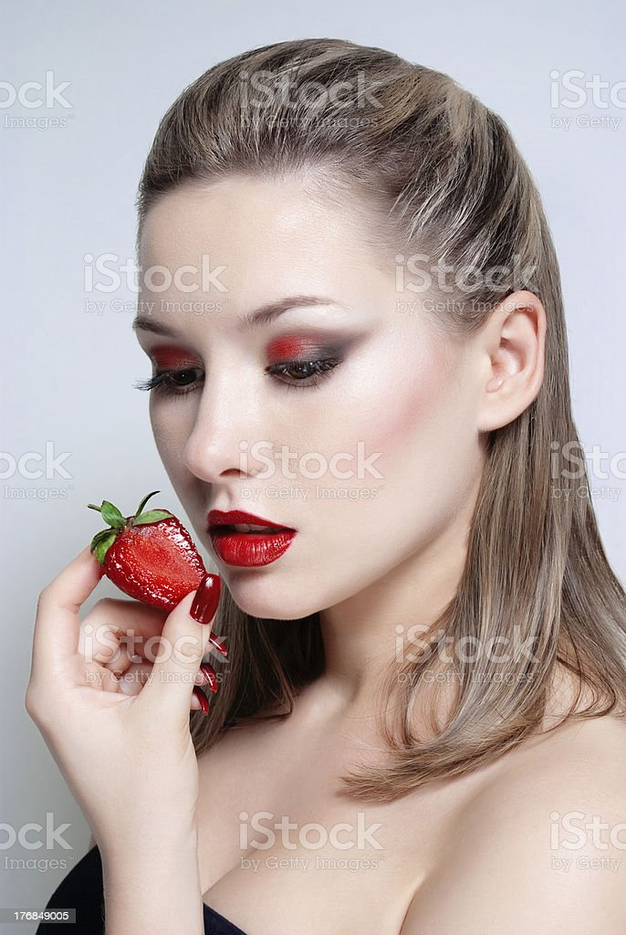 Young woman with strawberry royalty-free stock photo