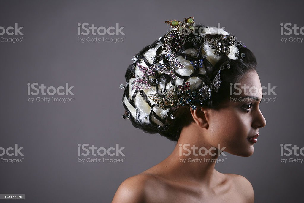 Young Woman with Styled Hair and Butterflies royalty-free stock photo