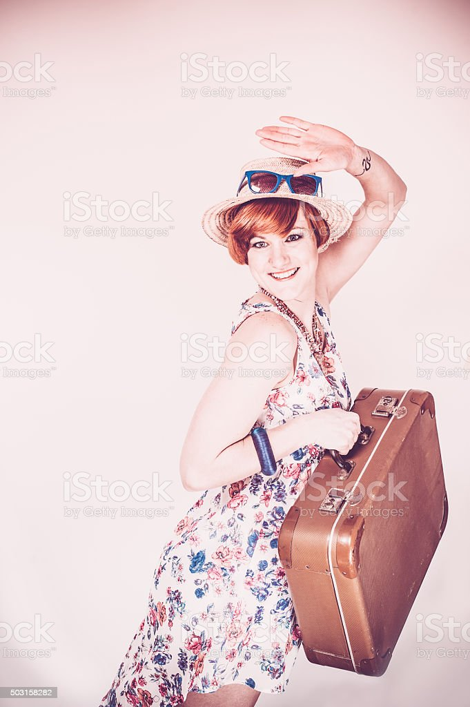 Young woman with suitcase in retro style stock photo