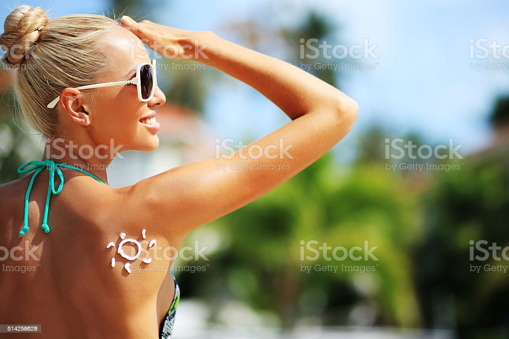 Young woman with sun shape on the shoulder stock photo