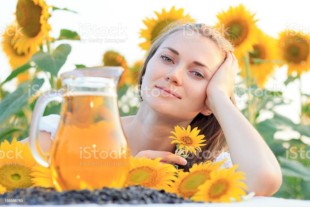 Young woman with sunflower oil jug stock photo
