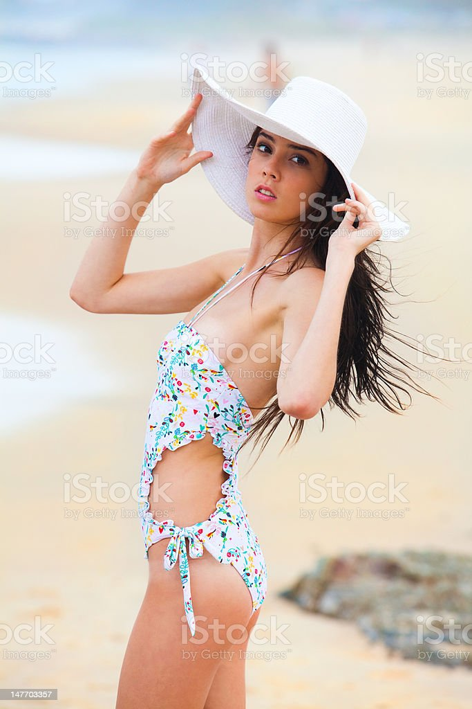 Young Woman With Swimsuit And Hat At The Beach royalty-free stock photo