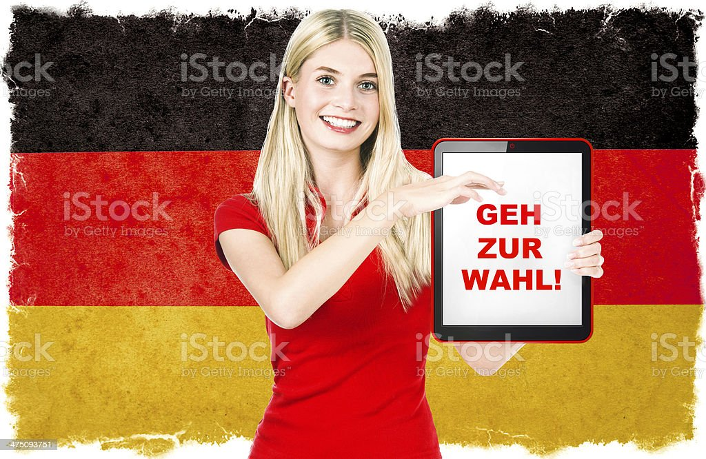 Young woman with Tablet PC and Germany flag on background royalty-free stock photo
