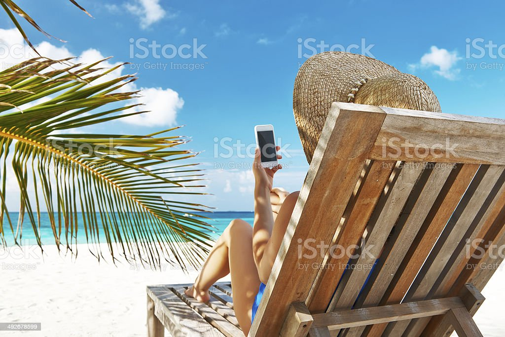 Young woman with tablet pc at the beach royalty-free stock photo