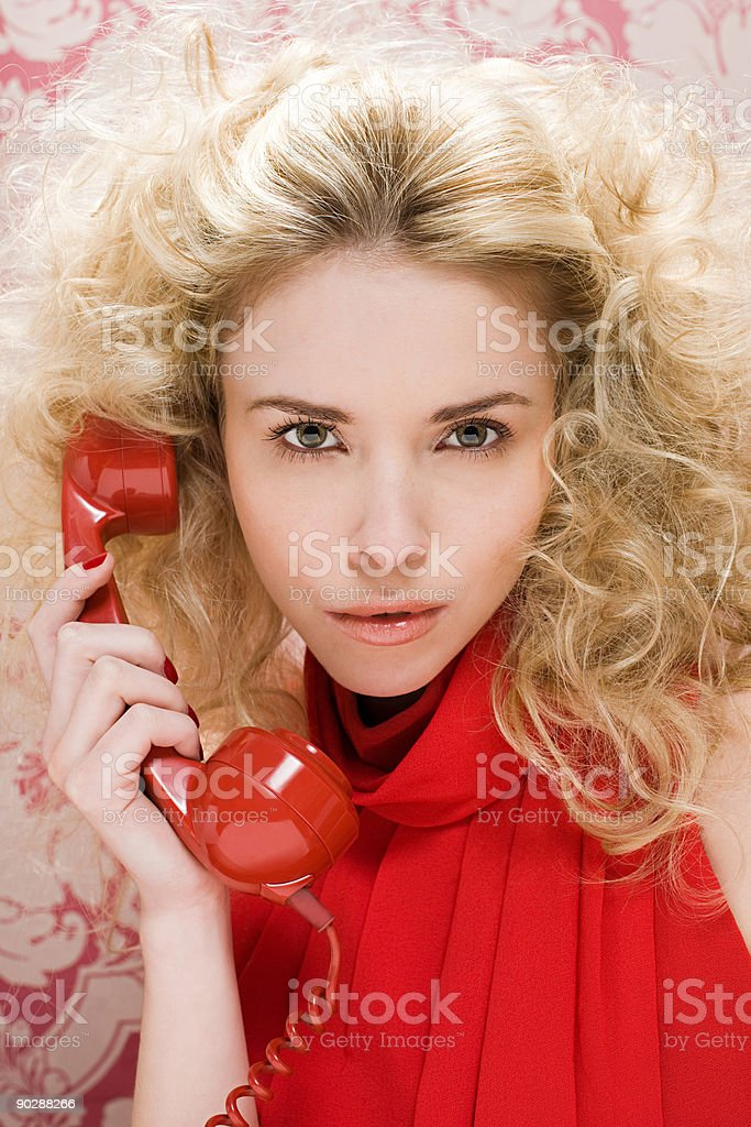 Young woman with telephone handset stock photo