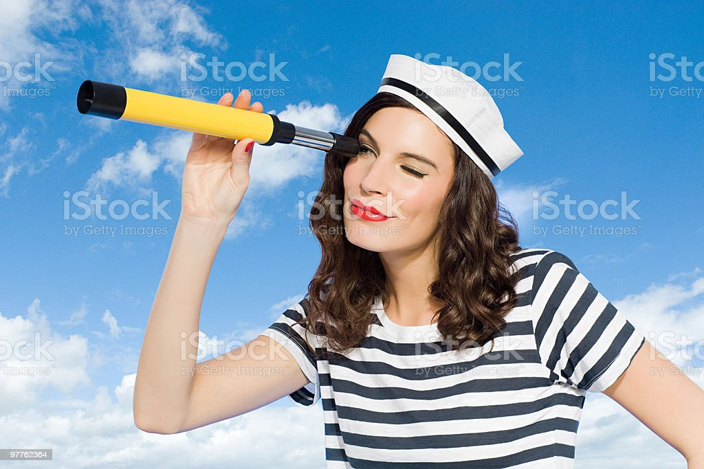 Young woman with telescope stock photo