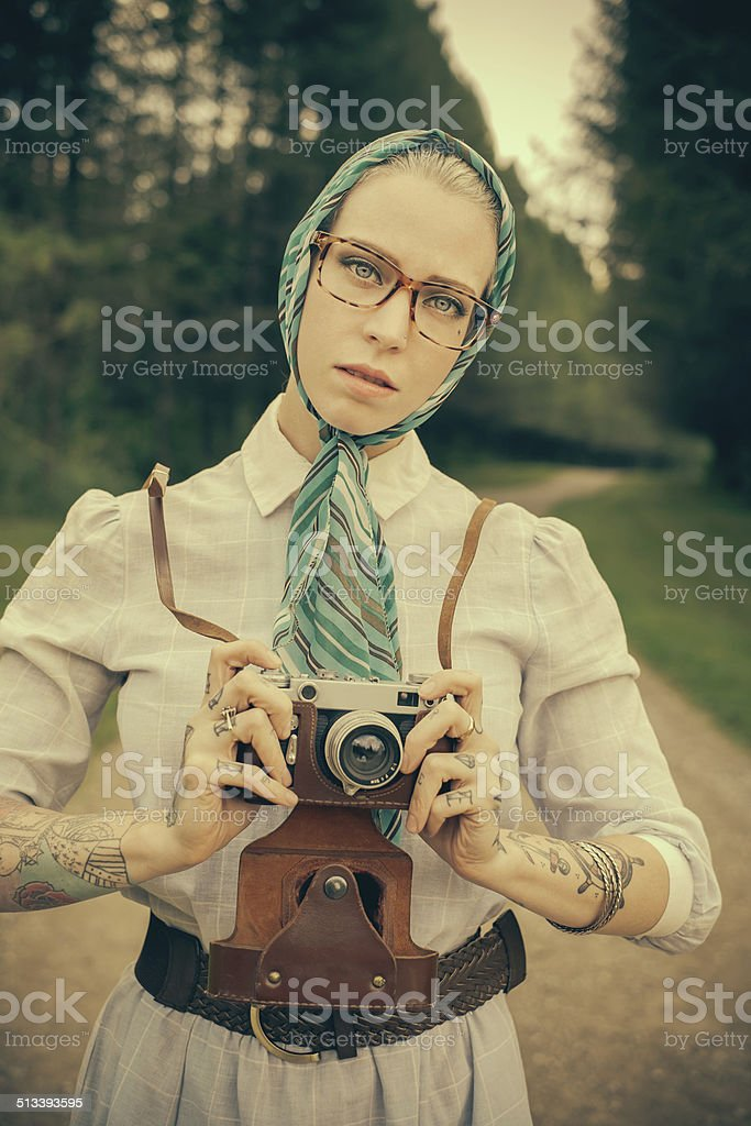 Young woman with the vintage camera stock photo