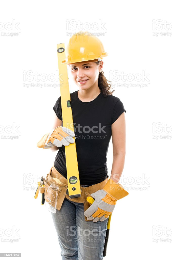 Young woman with toolbelt gloves and level, isolated on white royalty-free stock photo