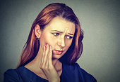 young woman with toothache crown problem pain