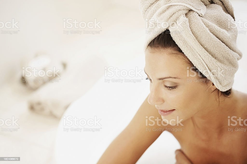 Young woman with towel wrapped around head royalty-free stock photo