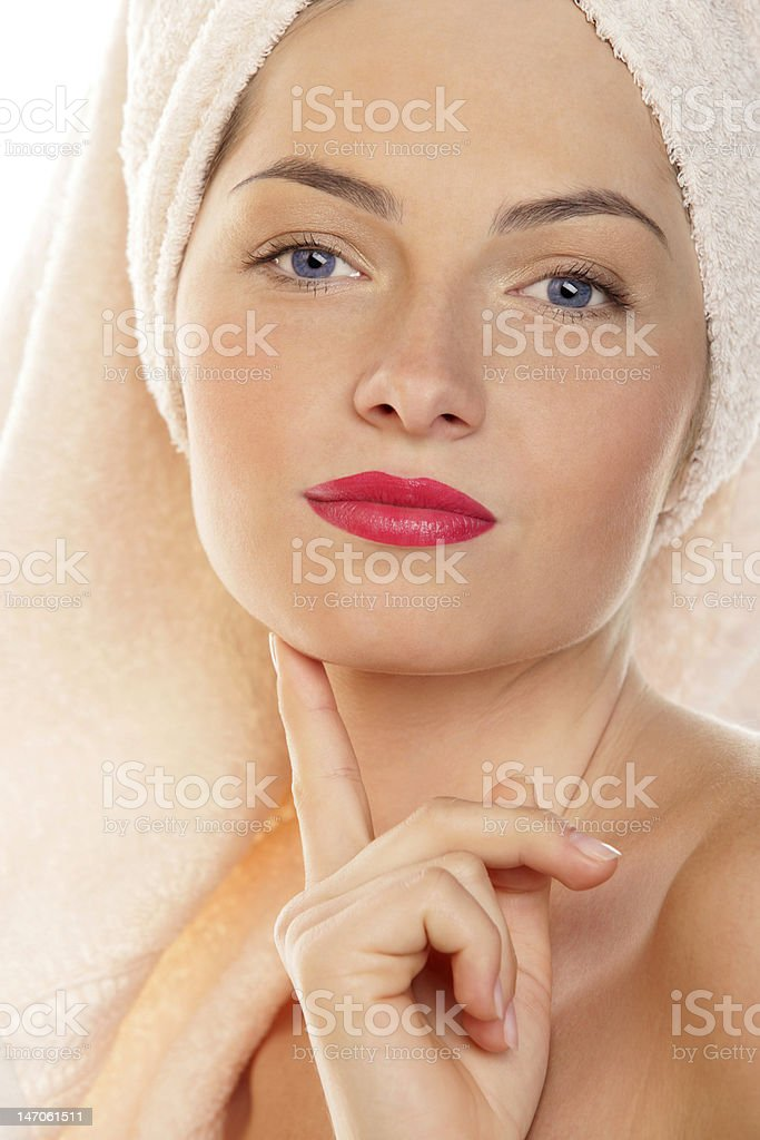 Young woman with towel wrapped around her head royalty-free stock photo