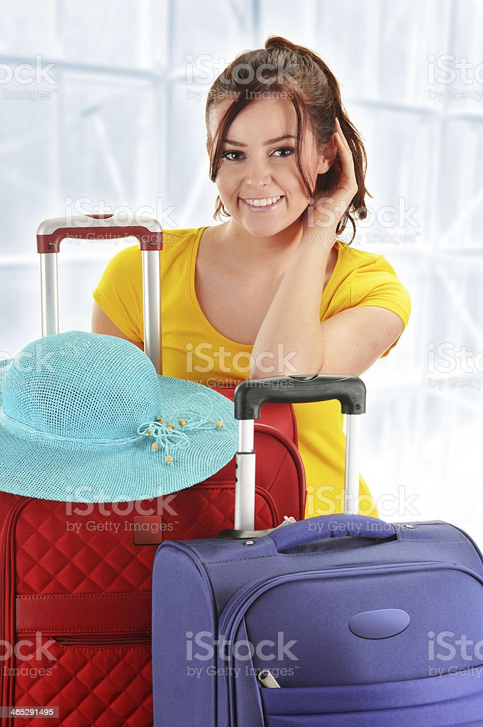 Young woman with travel suitcases. Tourist ready for a trip stock photo