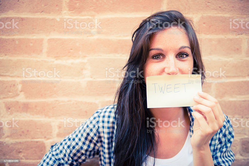 Young woman with tweet paper royalty-free stock photo