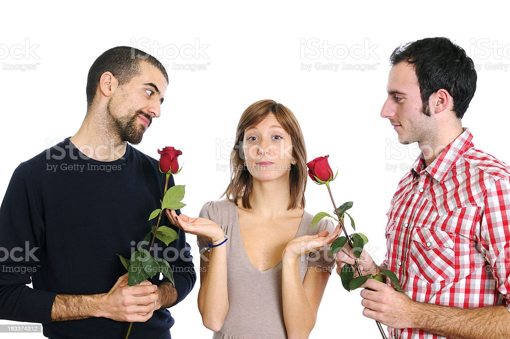 Young Woman with Two Boyfriends in Conflict stock photo