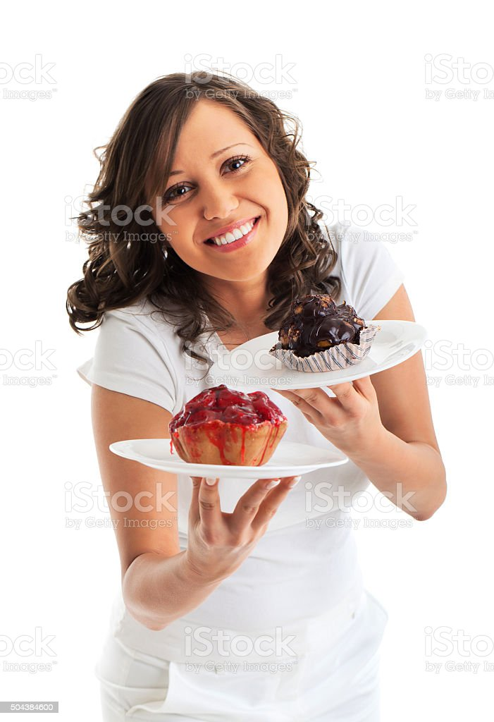 Young woman with two cakes stock photo