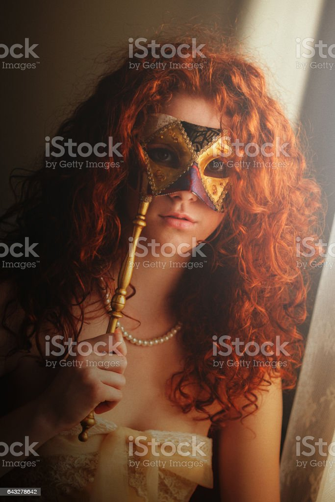 Young woman with venetian mask stock photo