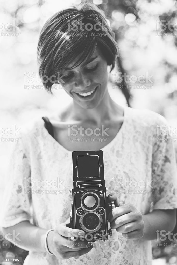 Young Woman with Vintage Camera stock photo