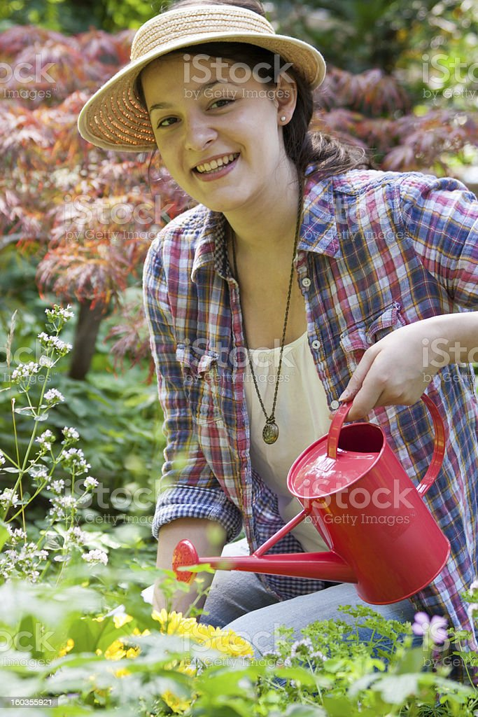 young woman with watering can royalty-free stock photo