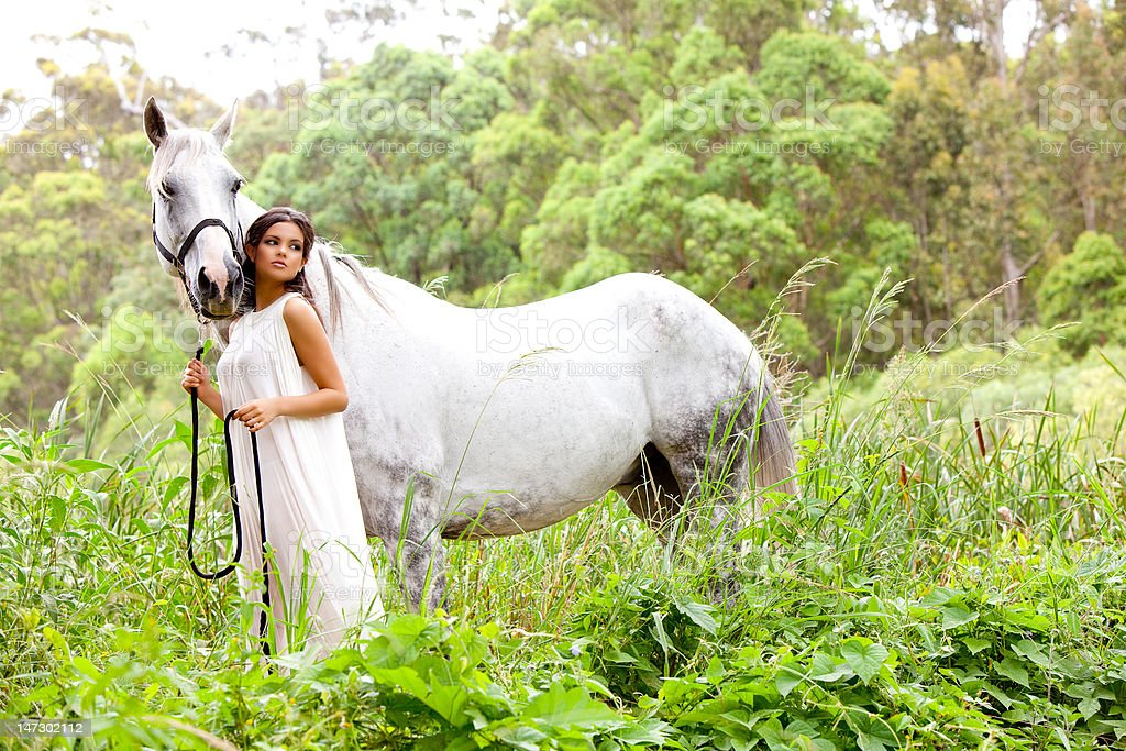 Young Woman With White Horse royalty-free stock photo