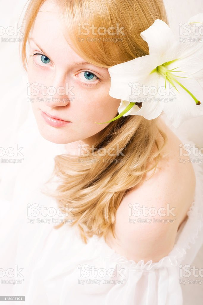 young woman with white lily royalty-free stock photo