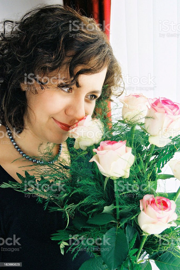 Young woman with white roses stock photo