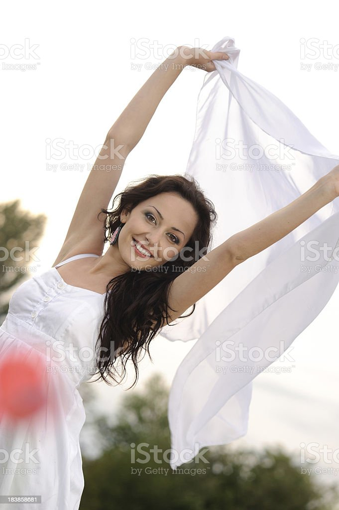 Young woman with white scarf stock photo