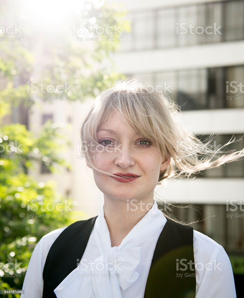 Young woman with windswept hair. stock photo