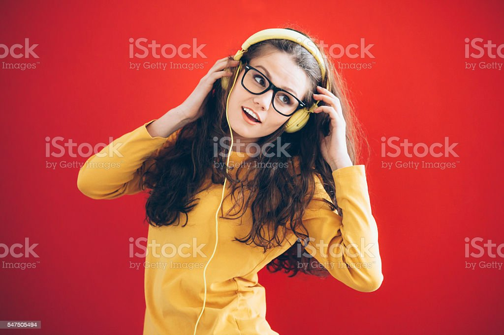 Young woman with yellow headphones stock photo