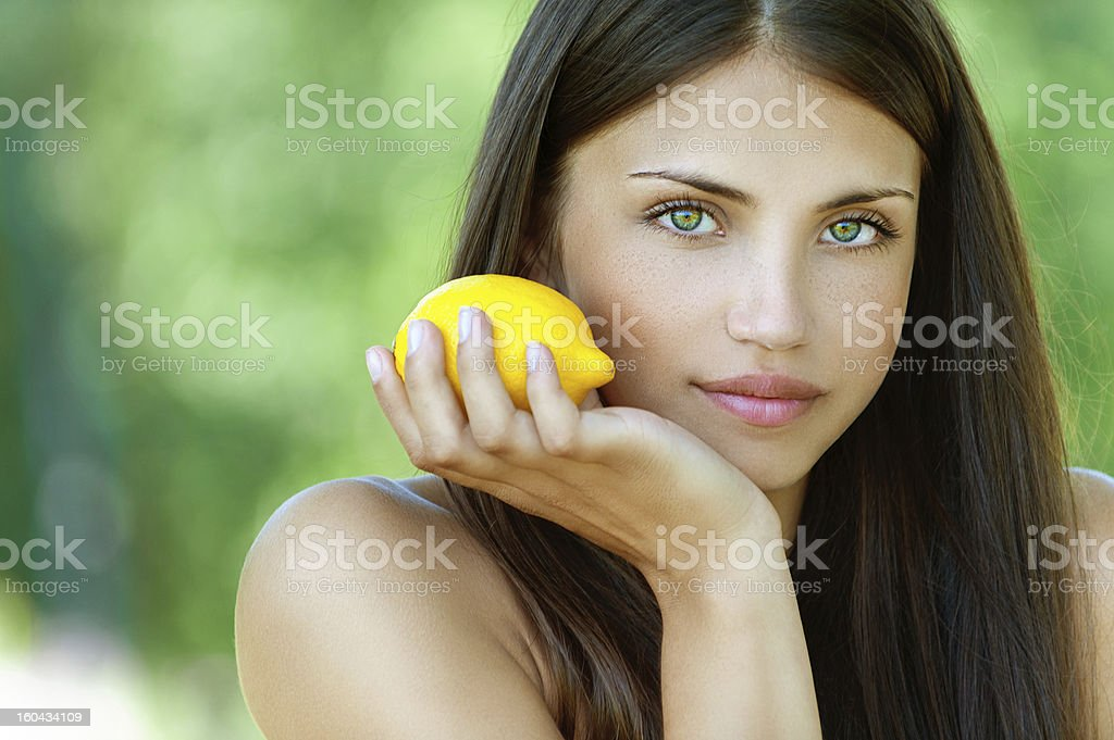 young woman with yellow lemon royalty-free stock photo