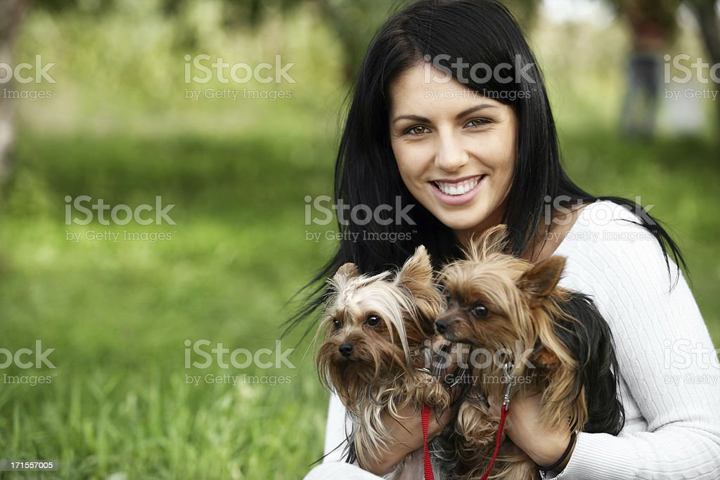young woman with yorkshire terriers royalty-free stock photo