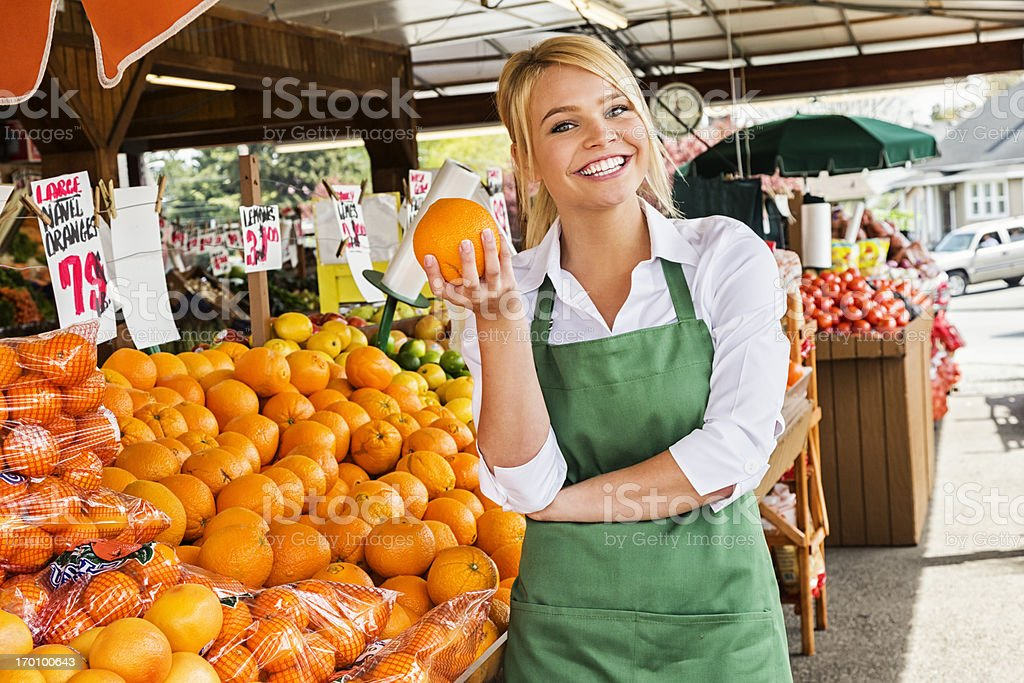 Young Woman Working at Farmers Market royalty-free stock photo