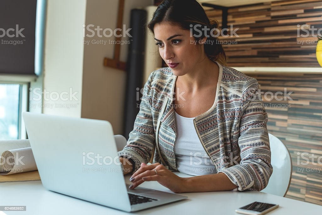 Young Woman Working at her office stock photo