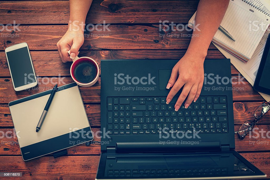 Young Woman Working At Home CNGLBUS876 stock photo