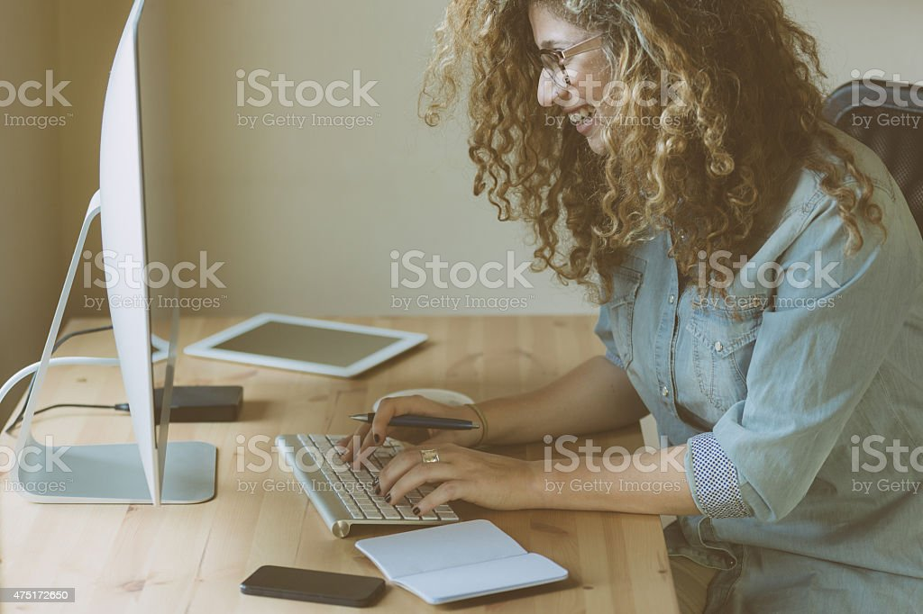 Young woman working at home or in a small office stock photo