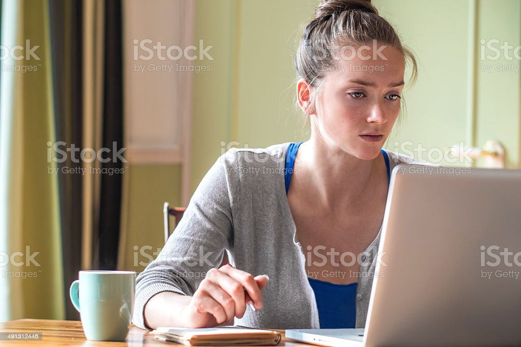 Young woman working from home stock photo