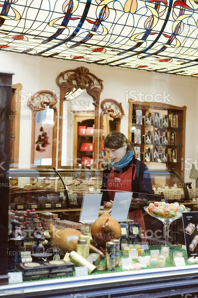 Young woman working in a chocolate shop stock photo