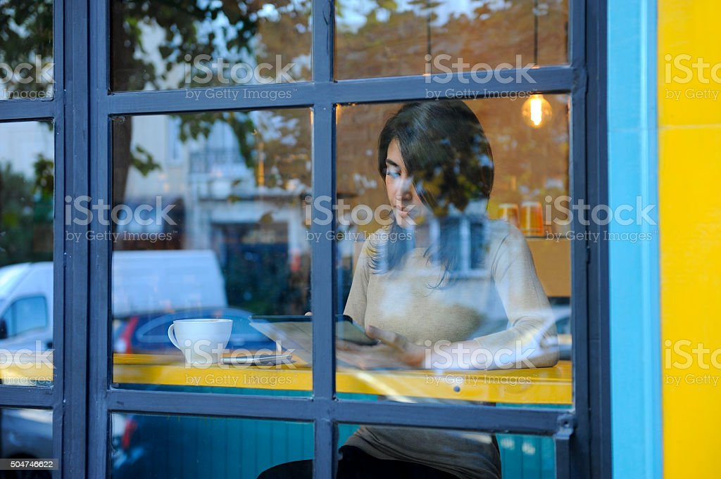 Young woman working in a coffee shop stock photo