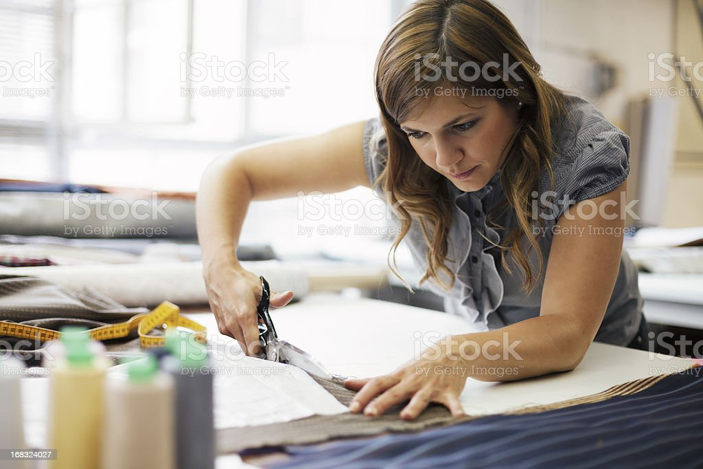 young woman working in clothes manufacture stock photo