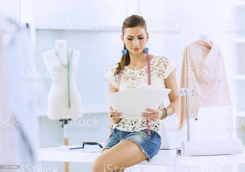Young woman working in design studio royalty-free stock photo