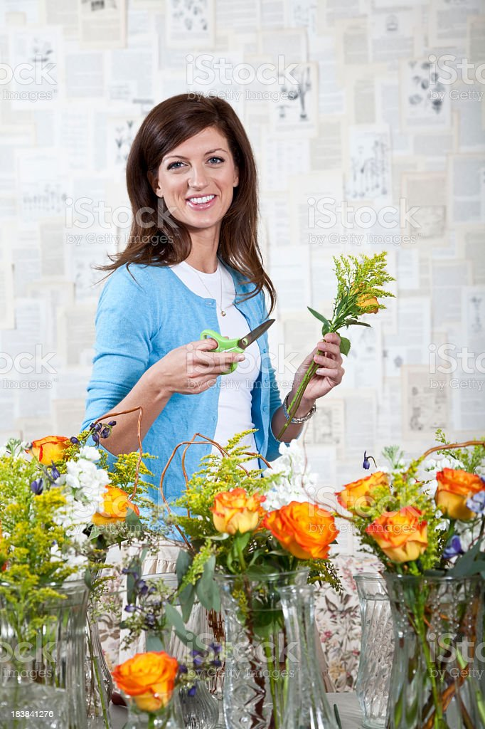 Young woman working in florist shop royalty-free stock photo