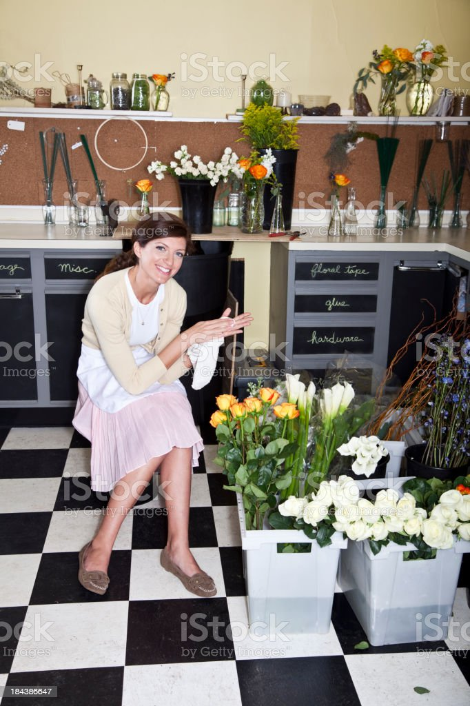 Young woman working in florist shop stock photo