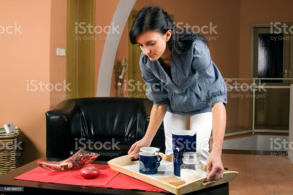 Young woman working in living-room stock photo
